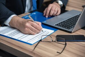 Houston traffic accident lawyer filling out paperwork