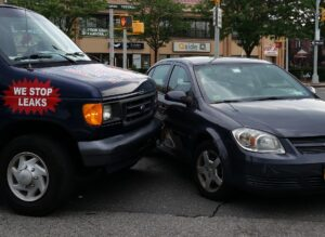 Van collides with sedan car, drivers may need a Houston accident injury attorney