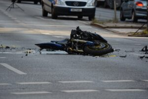crashed motorcycle on road call houston car crash attorney
