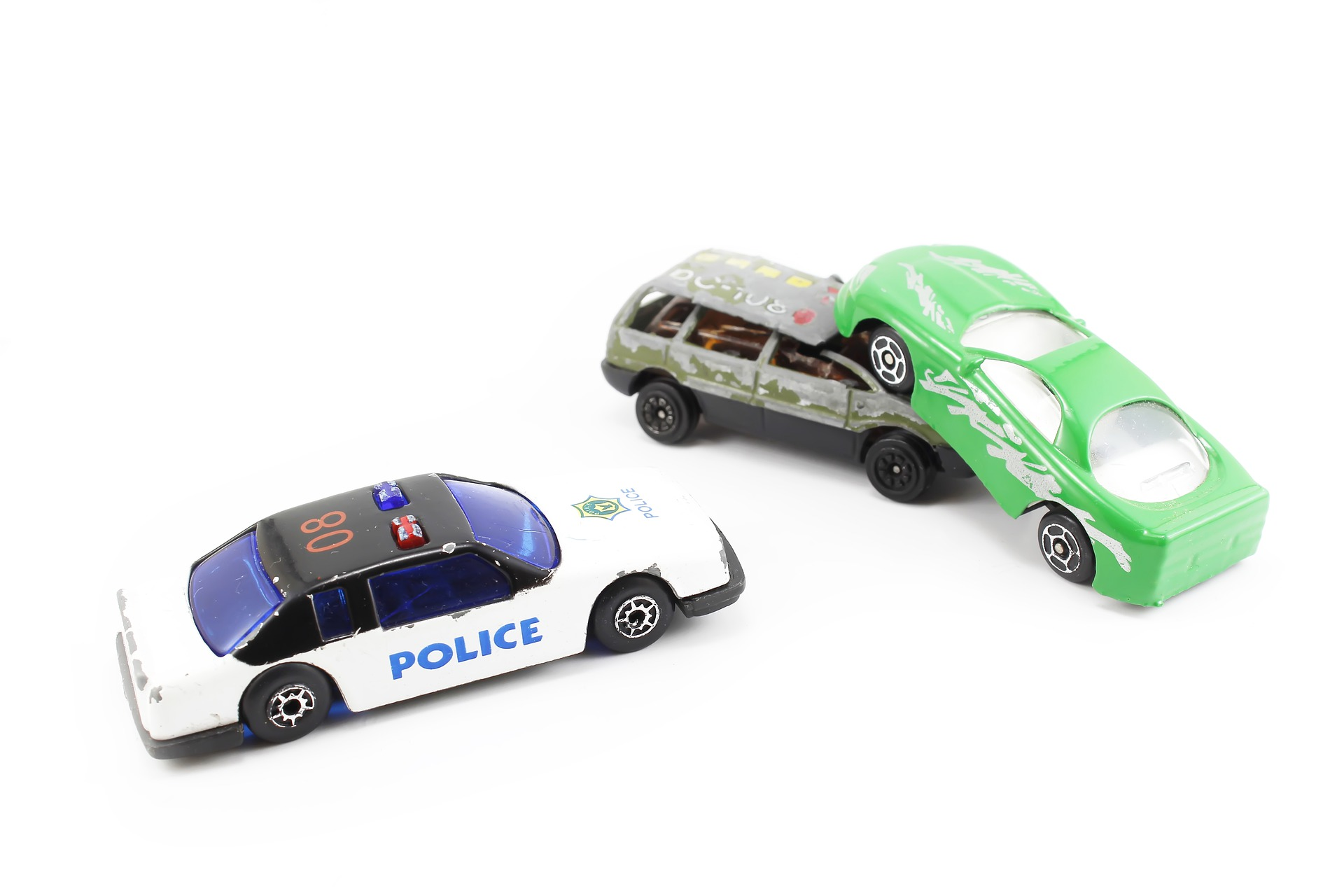 toy car simulating a car crash call Houston accident injury attorney for help