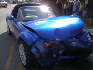 crumpled convertible car due to illegal street race - auto accident claims in Houston