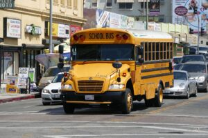 School bus driving on street may need Houston bus accident attorney after a crash.
